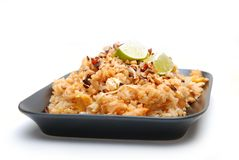 Rice dish. Asian rice dish served on black plate, isolated on white background Stock Photo