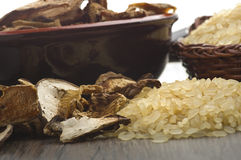 Rice and dried porcini mushrooms Royalty Free Stock Photos