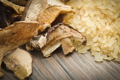 Rice and dried porcini mushrooms Stock Photo