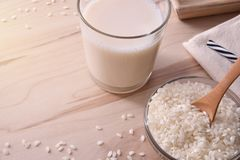Rice drink in a glass on a wood table elevated Royalty Free Stock Images