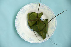 Rice dumpling. Steamed Chinese rice dumplings (zongzi) wrapped in bamboo leaves, filled with glutinous/sticky rice, pork, mushrooms, and peanuts. These are eaten Royalty Free Stock Image