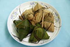 Rice dumpling. Steamed Chinese rice dumplings (zongzi) wrapped in bamboo leaves, filled with glutinous/sticky rice, pork, mushrooms, and peanuts. These are eaten Stock Images