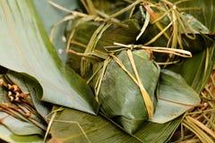 Rice dumpling on bamboo leaves Stock Photo