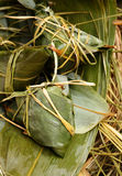 Rice dumpling on bamboo leaves Royalty Free Stock Photo