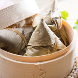Rice dumpling. Hot rice dumpling or zongzi. Traditional steamed sticky glutinous rice dumplings. Chinese food dim sum. Asian cuisine Royalty Free Stock Images