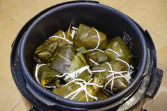 Rice dumpling (zongzi) in a high pressure cooker Stock Photos