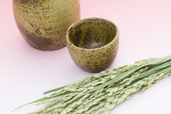 Rice ear and sake bottle Royalty Free Stock Photography