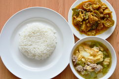 Rice eat with egg soup and spicy stir fried wild boar curry Royalty Free Stock Photography