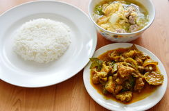 Rice eat with spicy stir fried wild boar curry and egg soup Stock Image