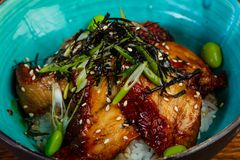 Rice with eel. Served sesame seeds royalty free stock image