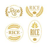 Rice emblems labels badges set. Vector vintage illustration. Rice emblems labels badges set. Golden logotypes collection for packaging advertising. Vector Royalty Free Stock Photo