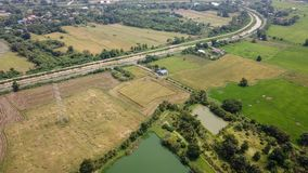 Rice farm on harvesting season by farmer with combine harvesters. And tractor on Rice field plantation pattern. photo by drone from bird eye view in countryside stock photos