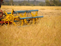Rice farm and machine Royalty Free Stock Image