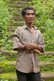 Rice farmer. BALI - JANUARY 24. Handicapped rice farmer holding sickle in Bali on January 24, 2012 in Bali, Indonesia. Indonesia is currently the third-largest Royalty Free Stock Image