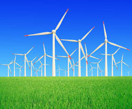 Rice farms Modern wind turbines royalty free stock image