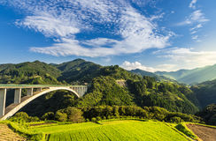 Rice field landscape and arch bridge in Takachiho, Miyazaki, Jap Stock Images