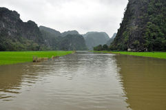 Rice fields and limestone cliffs, Tam Coc, Vietnam Stock Photos