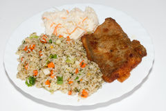 Rice with fisch and vegetable. Brown rice with fisch and vegetable stock photo