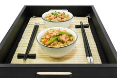 Rice with a fish and chiсken on the tray. Rice with a fish and chiсken in Japanese on the tray Stock Photography