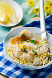 Rice with fish and a leek in ceramic bowl Royalty Free Stock Photos