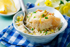 Rice with fish and a leek in ceramic bowl Stock Photos