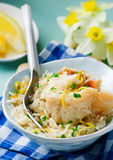 Rice with fish and a leek in ceramic bowl Stock Image