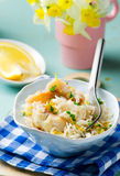 Rice with fish and a leek in ceramic bowl Stock Photo