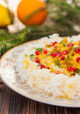 Rice with fish in orange sauce for a Christmas or New Year dinner Stock Image