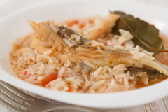 Rice with fish on the plate Royalty Free Stock Photos