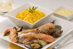 Rice and fish. Spanish cuisine. Arroz abanda. Stock Image