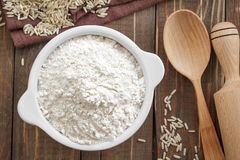 Rice flour. In a bowl on a wooden table Royalty Free Stock Photo