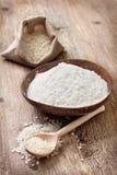 Rice flour in a wooden bowl Stock Photos