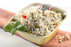Rice and fork in the bowl Stock Images
