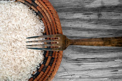 Rice and fork wood background Royalty Free Stock Photo
