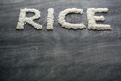 Rice in the form of words. View from above. Stock Photos