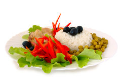 Rice and fried chicken. Rice and fried chicken with vegetable (lettuce, pepper,  olives and green peas) decoration Royalty Free Stock Images