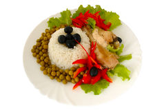 Rice and fried chicken. Rice and fried chicken with vegetable (lettuce, pepper,  olives and green peas) decoration Stock Photo