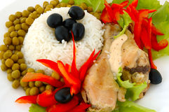 Rice and fried chicken. Rice and fried chicken with vegetable (lettuce, pepper, olives and green peas) decoration stock image