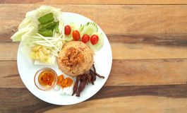 Rice with fried mackerel boil egg shrimp paste chili sauce and v. Etgetable and pig fried original thai food royalty free stock photo