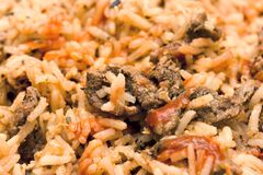 Rice and Fried Meat. Close up view of cooked rice and fried meat, served as part of a meal Stock Photos