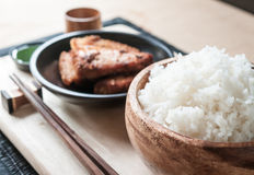 Rice and Fried pork in dish Stock Photos