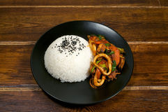 Rice with fried squid Stock Photos