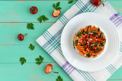 Rice and fried vegetables asparagus beans, carrots - vegan diet garnish. Decorated layers of salad on a white plate. The top view Royalty Free Stock Photos