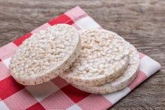 Rice galettes on a kitchen napkin. On wooden texture. Stock Image