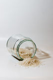 Rice. Glass jar with rice falling out Royalty Free Stock Images