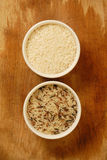 Rice grain. Two type of rice grain on wooden table Royalty Free Stock Photography