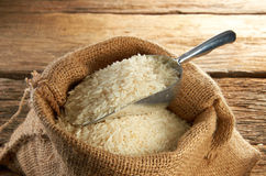 Rice Grain. Mood shot of rice grain on wooden table Royalty Free Stock Image