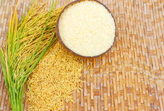 Rice grain on bamboo background. Stock Photo