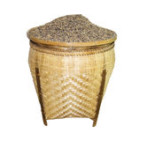 Rice grain in basket isolated on white background Stock Photography