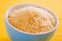 Rice grain in bowl Royalty Free Stock Image